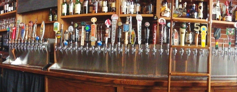 A panoramic view of some of the beer taps at Bridge